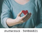red paper heart in woman hands. ... | Shutterstock . vector #564866821