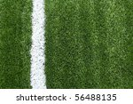 Soccer field with white lines on grass - stock photo
