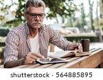 business on fresh air. handsome ... | Shutterstock . vector #564885895