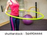 girl doing exercises with hoop | Shutterstock . vector #564904444