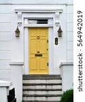 yellow door  | Shutterstock . vector #564942019