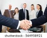 two specialists shaking hands...   Shutterstock . vector #564958921