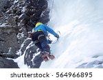 woman ice climbers climb a... | Shutterstock . vector #564966895