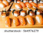 sushi with salmon on the wooden ... | Shutterstock . vector #564976279