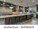 modern kitchen with brown... | Shutterstock . vector #564982645
