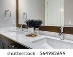 white and brown bathroom boasts ... | Shutterstock . vector #564982699