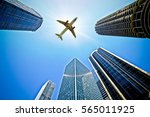 airplane flying over buildings... | Shutterstock . vector #565011925