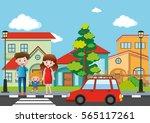 Family Crossing Street In...