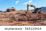 Excavator And Truck At...