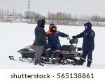 Small photo of KAZAN, RUSSIA - JANUARY 19, 2017: tree russian MoE lifeguards with snowmobile - rescuer on ice at winter day during Christ's baptism holiday