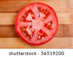 Red Tomato Slices On Chopping...