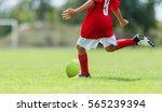 boy kicking soccer ball on... | Shutterstock . vector #565239394