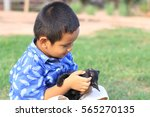 little boy playing with a black ... | Shutterstock . vector #565270135