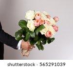 man with big beautiful bouquet... | Shutterstock . vector #565291039