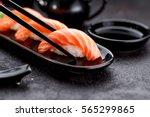 japanese cuisine. salmon sushi... | Shutterstock . vector #565299865