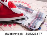 steam iron  ironing board and... | Shutterstock . vector #565328647