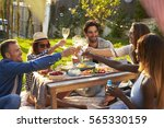 group of friends enjoying... | Shutterstock . vector #565330159
