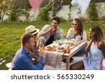 group of friends enjoying...   Shutterstock . vector #565330249