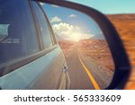 reflection of the highway in a... | Shutterstock . vector #565333609