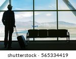 silhouette of traveling man in... | Shutterstock . vector #565334419