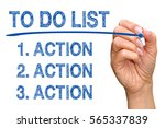 Small photo of To Do List - Action, Action, Action - female hand with marker writing blue text on white background