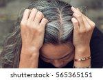 closeup sad asian young... | Shutterstock . vector #565365151