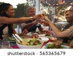 couples make a toast at dinner... | Shutterstock . vector #565365679