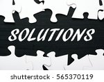 the word solutions in white... | Shutterstock . vector #565370119
