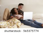 laughing teenage couple hanging ... | Shutterstock . vector #565375774