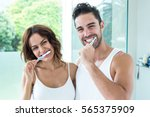 portrait of happy young couple... | Shutterstock . vector #565375909