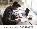 teenage boy wearing headphones... | Shutterstock . vector #565376299