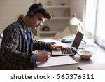 teenage boy wearing headphones... | Shutterstock . vector #565376311