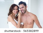 portrait wife smiling while... | Shutterstock . vector #565382899