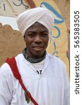 Small photo of KHAMLIA, MOROCCO - MARCH 21, 2012: Portrait of a young gnawa in the desert village