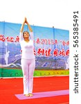 luannan county   august 7  yoga ... | Shutterstock . vector #565385491