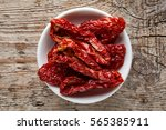 bowl of sun dried tomatoes on... | Shutterstock . vector #565385911