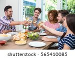 happy young friends toasting... | Shutterstock . vector #565410085