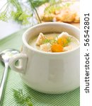 A bowl of creamy vegetable soup - stock photo