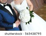 groom and bride holding hands... | Shutterstock . vector #565438795