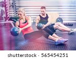 fit couple doing abdominal ball ... | Shutterstock . vector #565454251