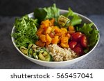 vegetarian buddha bowl with... | Shutterstock . vector #565457041