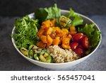 vegetarian buddha bowl with... | Shutterstock . vector #565457041