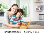 portrait of smiling mother and... | Shutterstock . vector #565477111