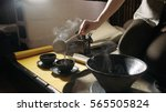 pouring tea with the help of... | Shutterstock . vector #565505824