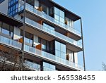 facade of a modern apartment... | Shutterstock . vector #565538455