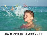 boy with floater sleeves... | Shutterstock . vector #565558744