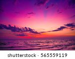 Stock photo nature in twilight period sunrise or sunset over the sea sea view from tropical beach with purple 565559119