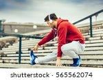 young fitness man runner... | Shutterstock . vector #565562074