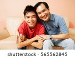 father and son looking at...   Shutterstock . vector #565562845