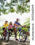 family  on bicycles  portrait ... | Shutterstock . vector #565566049
